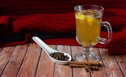 Hot drink mulled wine. Hot warming white mulled wine with cinnamon and anise Stock Image