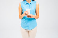 Hot drink in paper cup in hands Royalty Free Stock Images