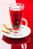 Hot drink with plum Stock Photo