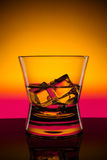 Hot drink shots in bar on color abstract background Stock Photography