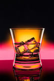 Hot drink shots in bar on color abstract background Stock Image