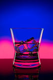 Hot drink shots in bar on color abstract background Stock Photos