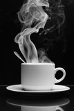Hot drink with steam. Cup of hot drink with steam over black background royalty free stock photography