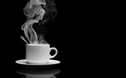 Hot drink with steam. Cup of hot drink with steam over black background royalty free stock photos