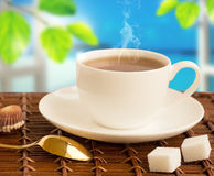 Hot drink with steam Stock Images