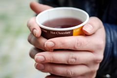 Hot Drink Tea in Paper Cup in Hands Close up with Blurred Background. Hot Drink Tea in Paper Cup in Hands Close up Stock Image