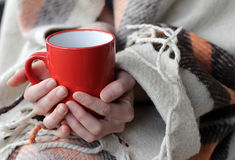 A hot drink and a warm blanket in the cold Stock Images