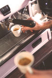 Hot drink in white mugs at the coffeehouse Stock Photography