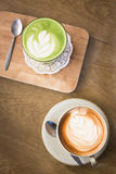 Hot drinks with latte coffee matcha green tea on wooden table Royalty Free Stock Images