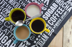 Hot drinks with a spoon Stock Images