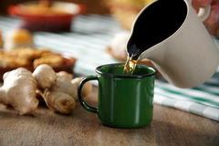 Free Hot Drip With Ginger On The Table With Some Brazilian Delicious. Royalty Free Stock Image - 95260596
