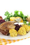 Hot Duck leg with red cabbage Stock Photos
