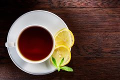 Hot earl grey tea with lemon slice top view on wood table royalty free stock photo