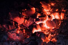 Hot Embers glowing and burning in stove. Close up Stock Photo