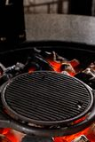 Hot empty charcoal BBQ grill with bright flames on Cookout. Concept royalty free stock photo