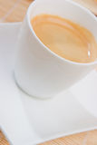 A hot espresso. A cup of espresso on a white saucer Stock Images