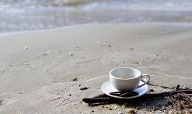 Hot espresso coffee on the beach. A cup of espresso coffee on the beach with cookies Stock Photos