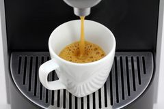 Hot Espresso coffee being poured Royalty Free Stock Image