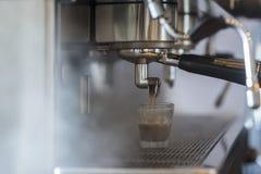 Hot espresso coffee brewing machine. Royalty Free Stock Photo