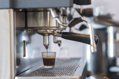 Hot espresso coffee brewing machine. Royalty Free Stock Photos