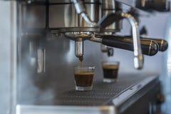 Hot espresso coffee brewing machine. Stock Photos