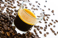 Hot espresso coffee with group of coffee beans Royalty Free Stock Image