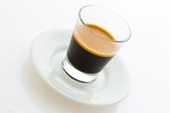 Hot espresso coffee on a small plate. Hot espresso coffee on a small ceramic plate Stock Photos