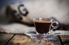 Hot espresso. Cup of hot espresso with coffee bag on background Royalty Free Stock Photo