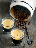Hot espresso cup with coffee beans Royalty Free Stock Images