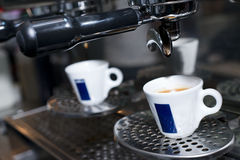 Hot espresso in cup on coffee machine Royalty Free Stock Photos