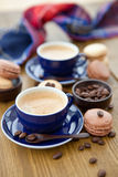 Hot espresso and french macaroons Stock Photography
