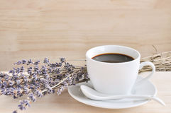 Hot espresso and lavender flower on wood table. In coffee shop Royalty Free Stock Photo