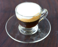 Hot  espresso with milk and foam in cup. Stock Photography