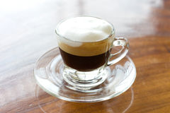 Hot  espresso with milk and foam in cup. Stock Images