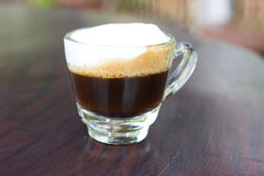 Hot  espresso with milk and foam in cup. Royalty Free Stock Photos