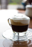 Hot  espresso with milk and foam in cup. Stock Photos