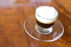 Hot  espresso with milk and foam in cup. Stock Image
