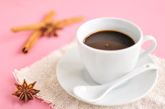 Hot espresso on wood table. Hot espresso and anise on wood table Royalty Free Stock Photo
