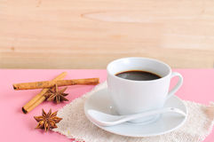 Hot espresso on wood table. Hot espresso and anise on wood table Stock Image