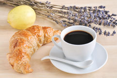 Hot espresso on wood table. Hot espresso and croissant with lavender flower ,lemon on wood table Stock Photography