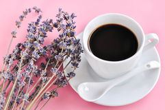 Hot espresso on wood table. Hot espresso and lavender flower on wood table Royalty Free Stock Photography
