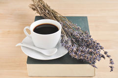 Hot espresso on wood table. Hot espresso and lavender flower with book on wood table Stock Image