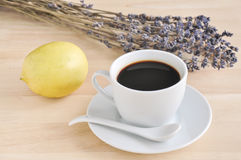 Hot espresso on wood table. Hot espresso and lavender flower ,lemon on wood table Stock Photos