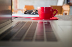 Hot espresso on working table Royalty Free Stock Images
