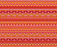 Hot Ethnic Pattern. Seamless geometric tribal pattern. Abstract pattern in hot colors of red and yellow. Cute background ornament Stock Photos