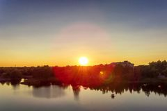 Hot evening sun in panorama landscape sunset on river Stock Photography