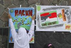 HOT FÖR INDONESIEN ANTI-KORRUPTIONKRIG Arkivbilder