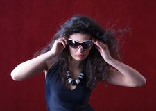 Hot fashion model wearing sunglasses Stock Photos