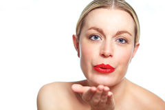 Hot female model blowing kiss stock photography