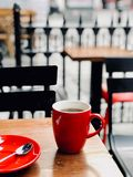 Hot Filtered / Filter Coffee with Steam in Red Cup in the Corner of the Street at Cafe Shop on Wooden Table Outside. Street Food stock photo